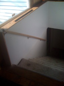 Basement stair handrail